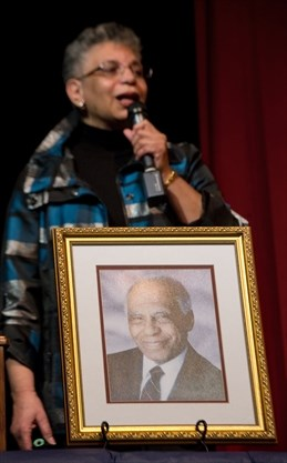 Daughter Bernice Carnegie with a framed picture of her dad, Herb Carnegie, at a memorial event held at Earl Haig Secondary School in 2012. - Rick Madonik/Toronto Star file photo