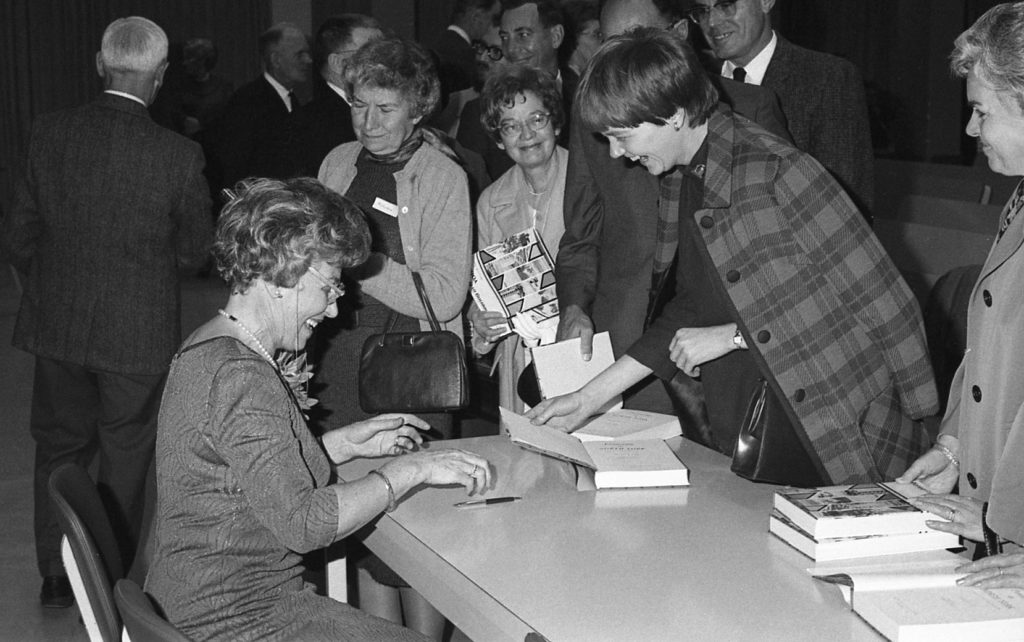 Patricia Hart, surrounded by a cheerful crowd, at her 1968 book signing, Gladys Allison Library, North York (Photo: Bill Chambers)