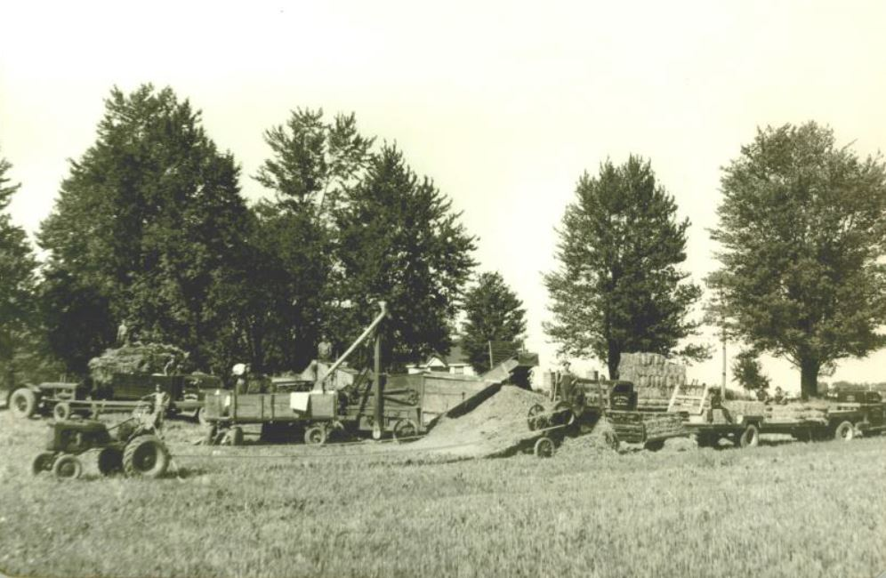 Threshing on west side of Yonge Street, north of the North York Civic Centre, circa 1945. Given to the NYHS by Robert McQuillan.