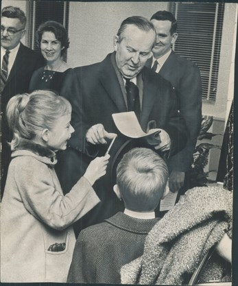 Prime Minister Lester B. Pearson signs autographs for Carol and Ian Bury on Jan. 22, 1965 at the official opening of Newtonbrook Secondary School in the area where Canada's 14th prime minister was born. - Harold Whyte/Toronto Star file photo