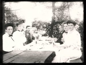 Gibson Family Dining Outdoors at Picnic Tables