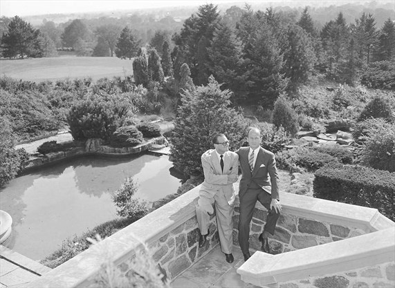 From the early 1950s, H. Rupert Bain with a guest at his Graydon Hall mansion. - City of Toronto archives photo