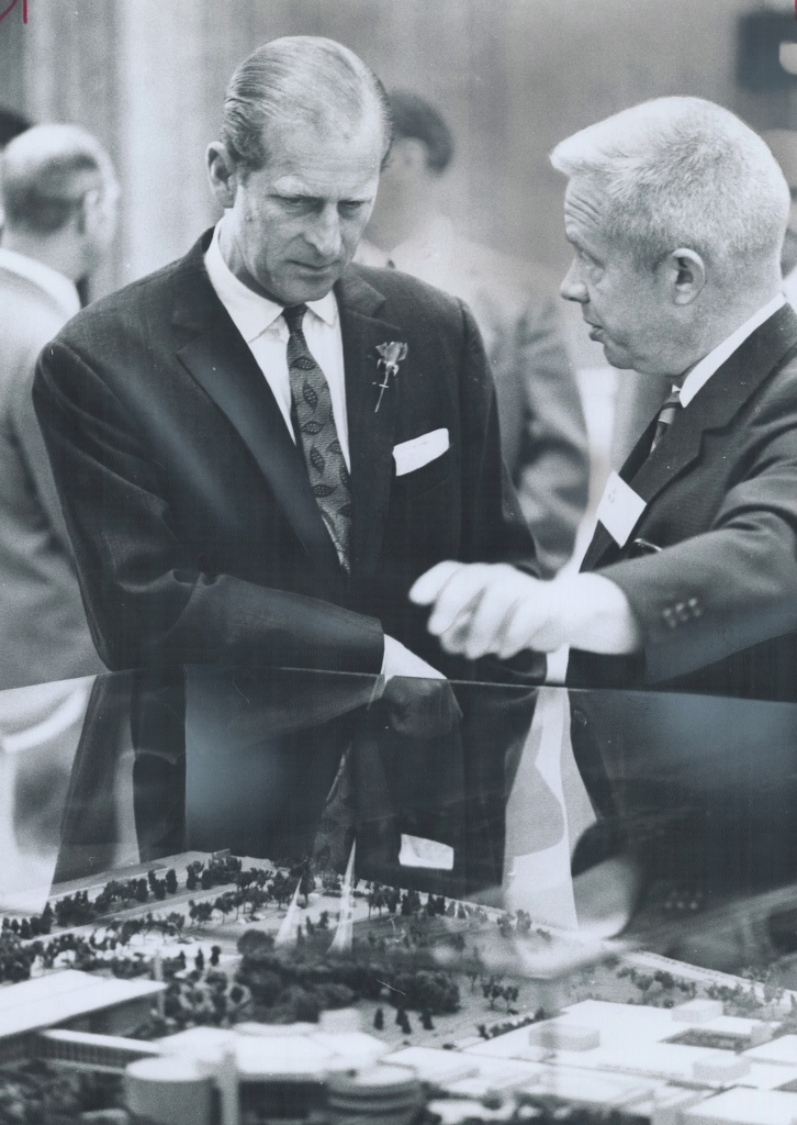 """Prince Philip visited the newly opened Ontario Science Centre yesterday and was shown around by the director-general; Dougles Omand (right). Scores of schoolchildren crowded around and his one-hour tour was shortened."" (Photo by Norman James courtesy Toronto Public Library under Toronto Star License)"
