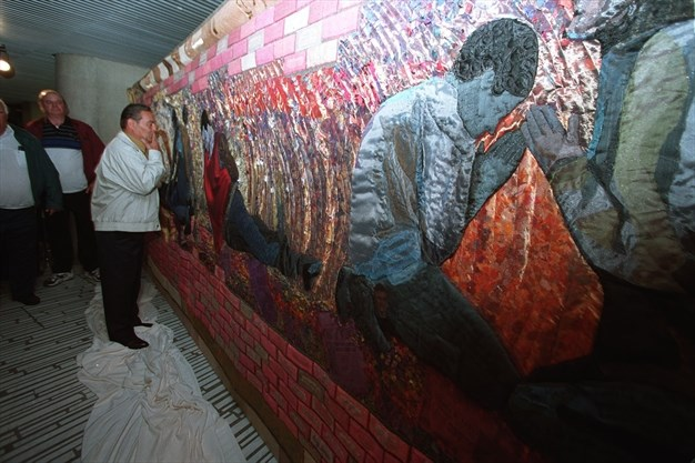 Antonio Fusillo, the brother of one of the workers who died in the Hoggs Hollow Disaster, is overcome with emotion as he examines Laurie Swim's memorial quilt unveiled at York Mills Subway station, March 17, 2010. - Jim Wilkes/Toronto Star file photo