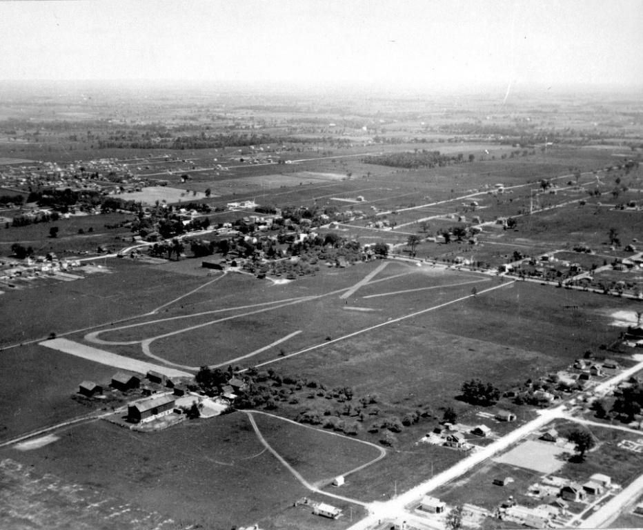 Aerial view c. 1927 of land east and west of Yonge St. between Burndale Ave. and north of Finch Ave. The airfield is now York Cemetery.